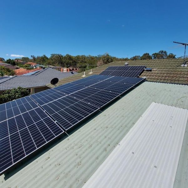 Tin Roof With Solar Panel Grid — Solar Specialists Gladstone
