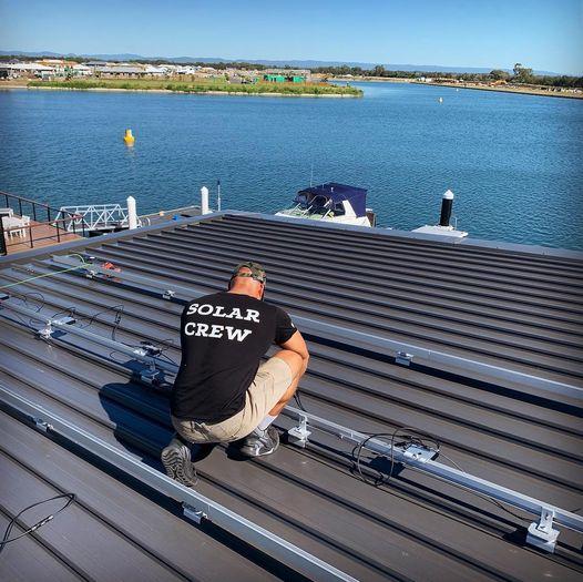Solar Technician Installing Mounts for Solar Panels — Solar Specialists Mackay